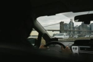 Man conducing a car.